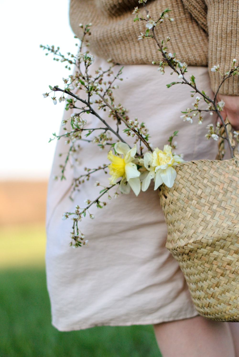 yellow flowers on brown woven basket
