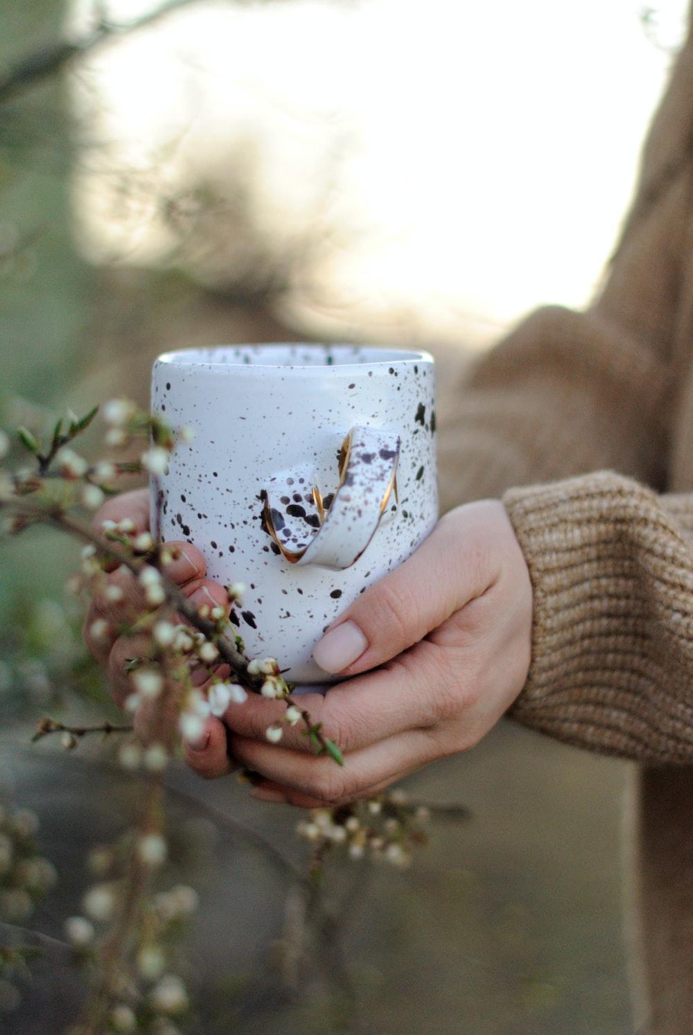 white and blue floral ceramic mug