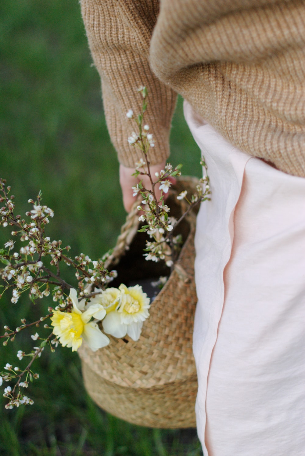 white and yellow flower on brown knit textile