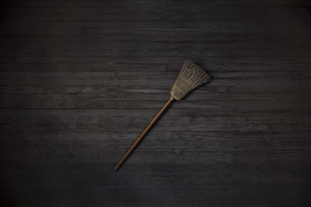brown and black brush on brown wooden table