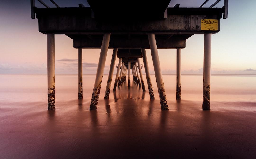 Warm Sunrise Under the Wharf In Hervey Bay, Queensland, Australia - unsplash
