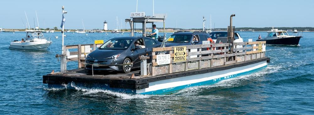 black sedan on brown wooden dock during daytime