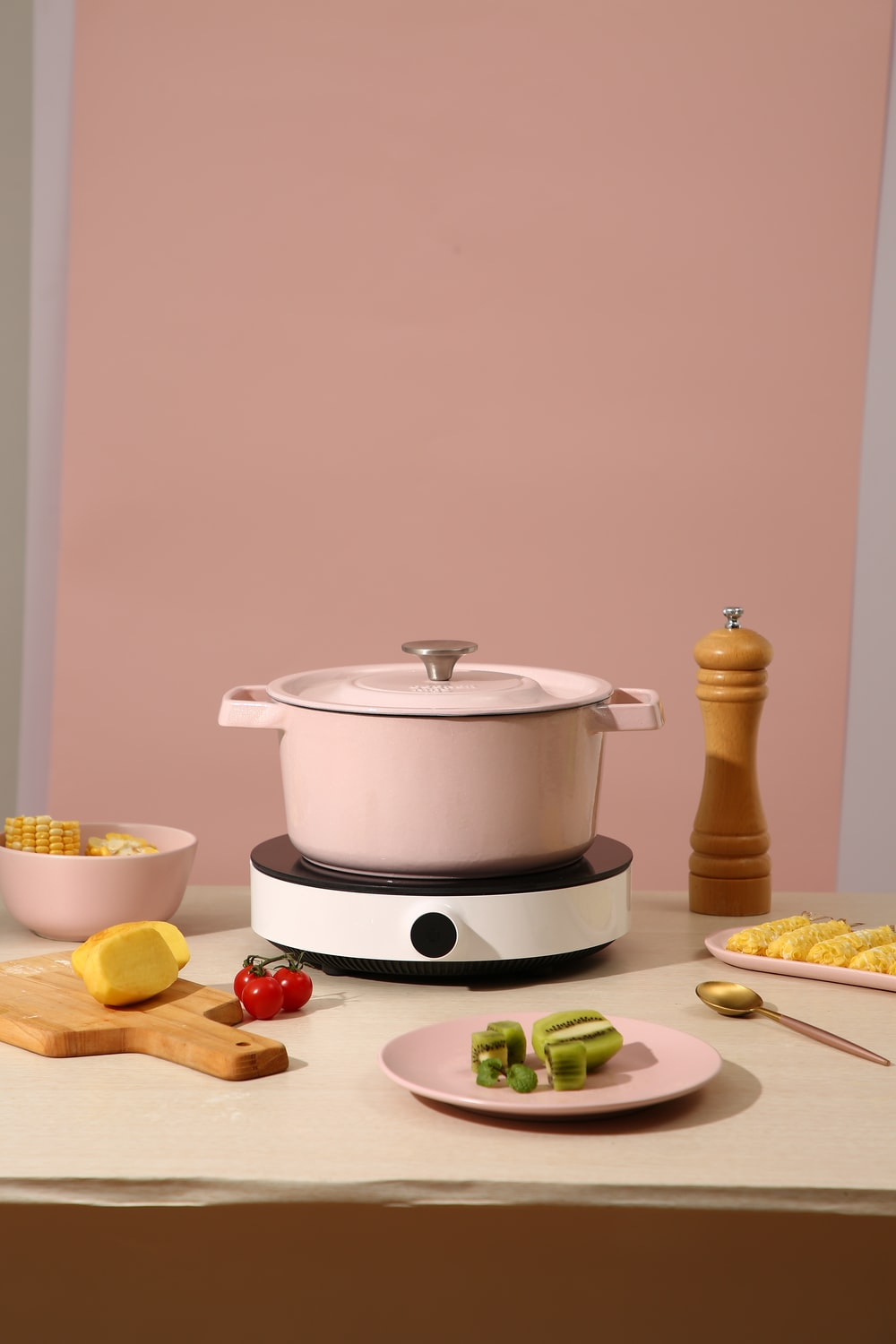 white rice cooker on brown wooden table