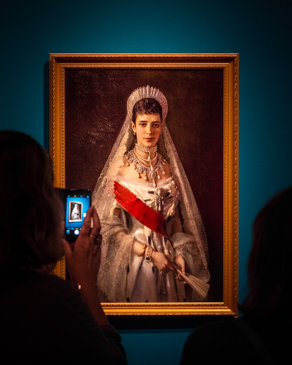 woman in white and red dress painting