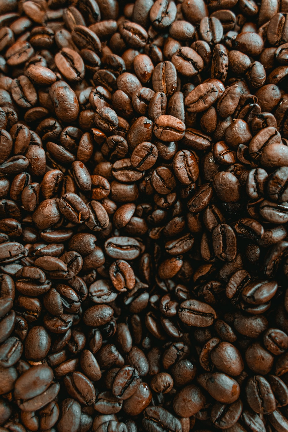 coffee beans on black surface