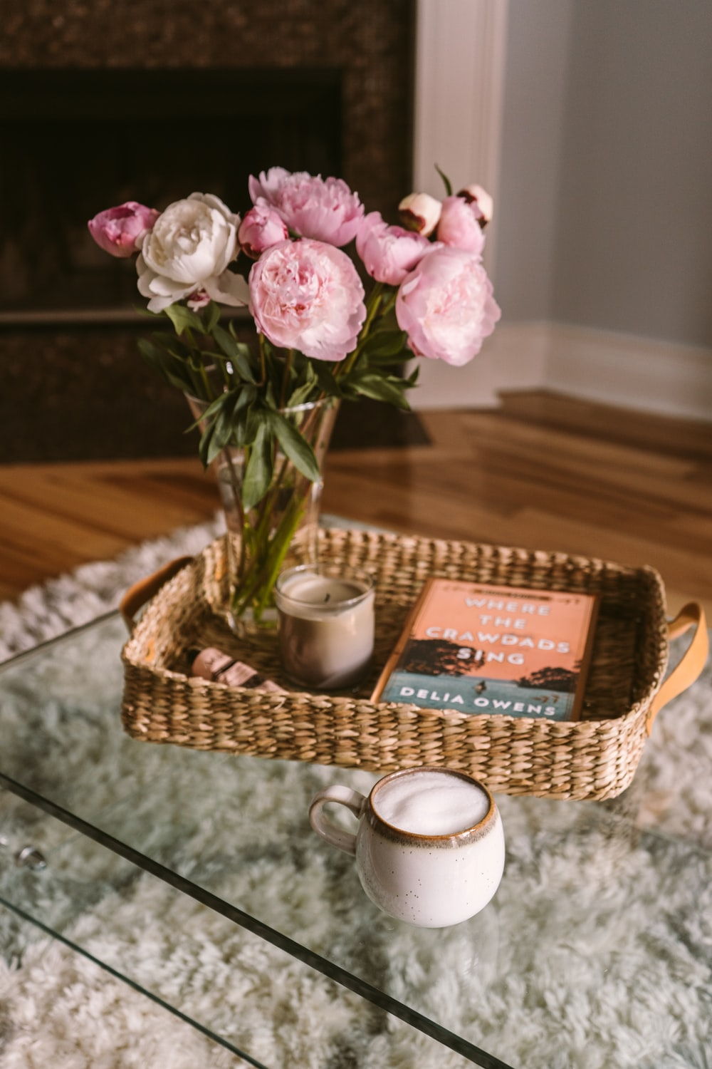 pink roses in brown woven basket
