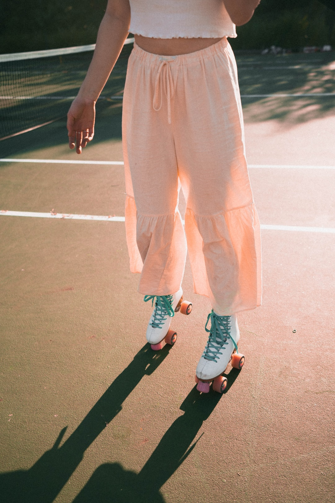 A GIRL WEARING WHITE IMPALA QUAD ROLLER SKATES ON A TENNIS COURT (RETRO/VINTAGE AESTHETIC). | Follow me on insta @calebrussell