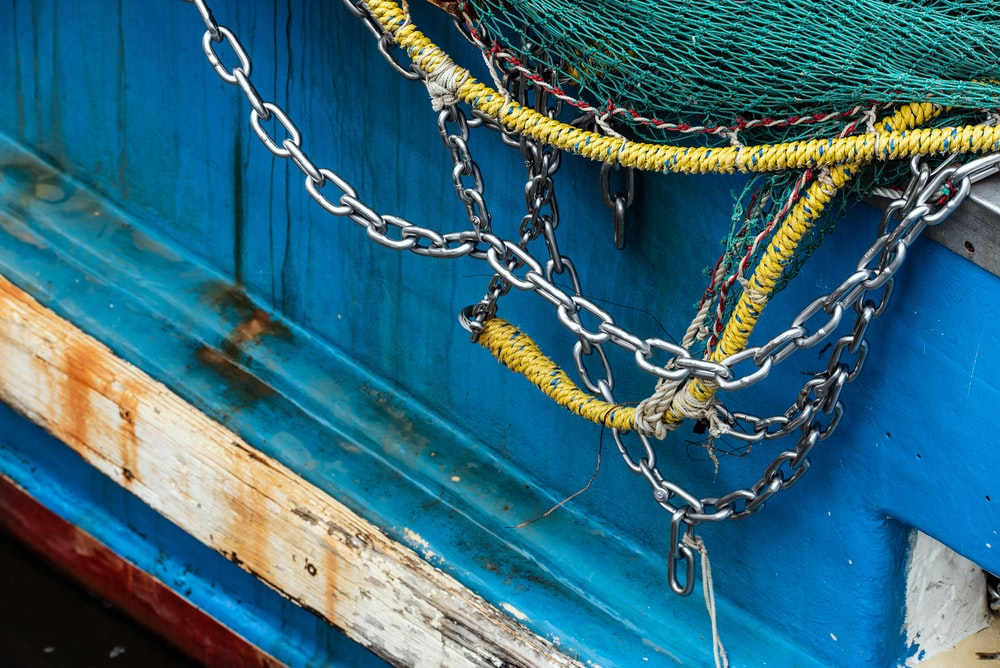 yellow and green rope on blue wooden door