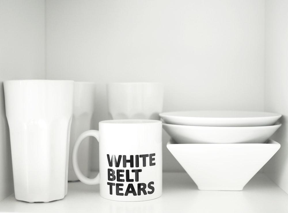 white ceramic mug beside white ceramic bowl