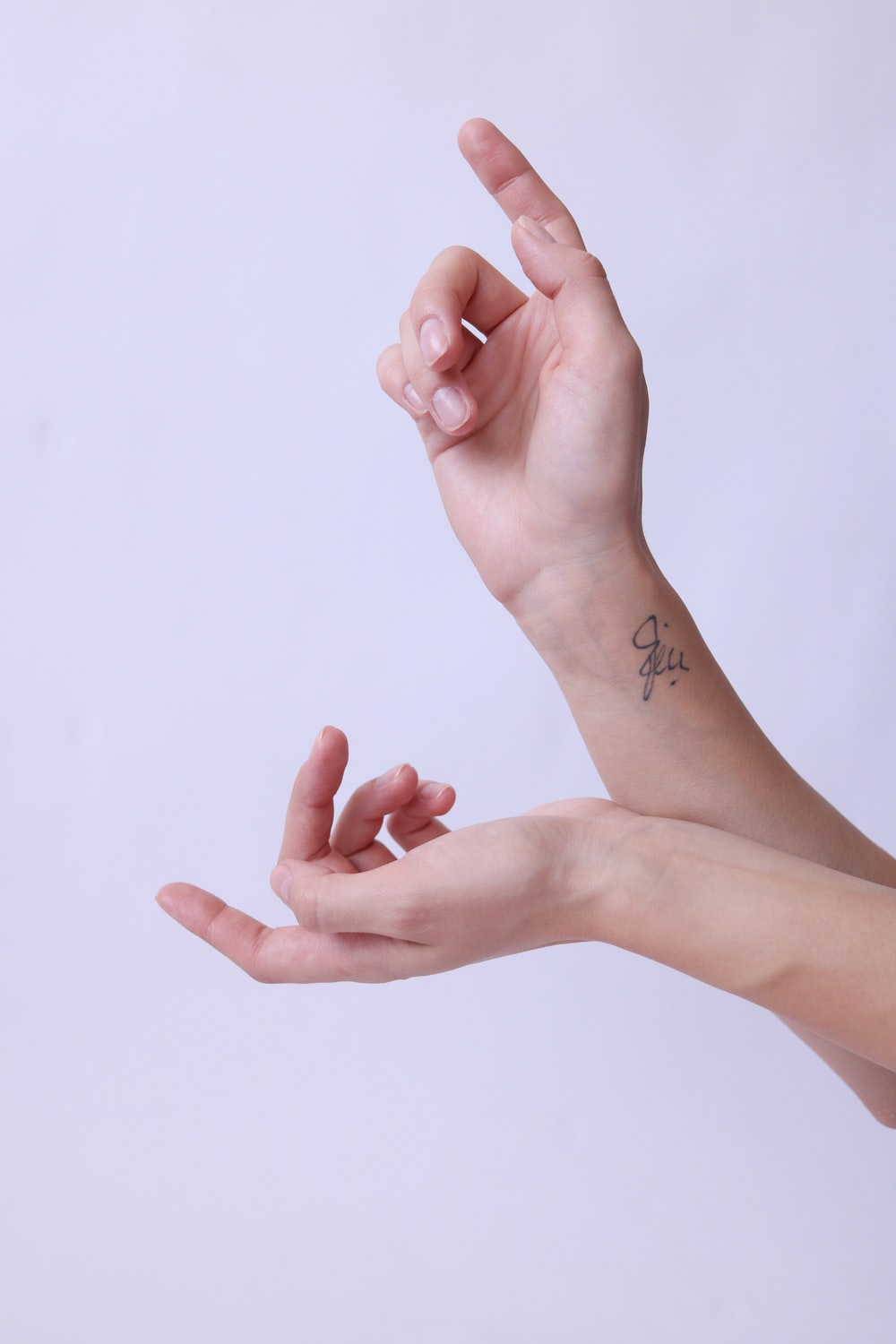 person with black tattoo on right hand