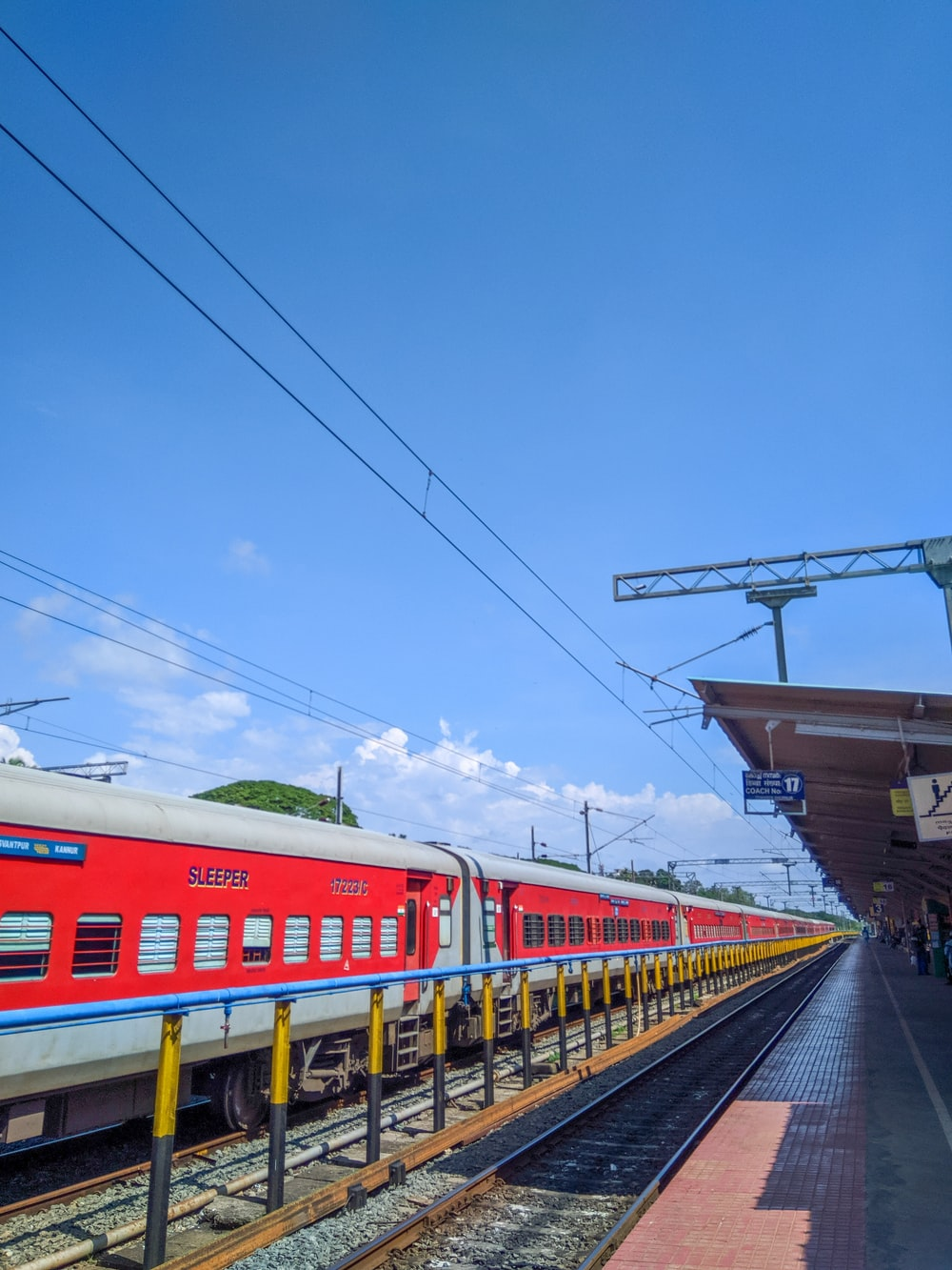 red and white train under blue sky during daytime