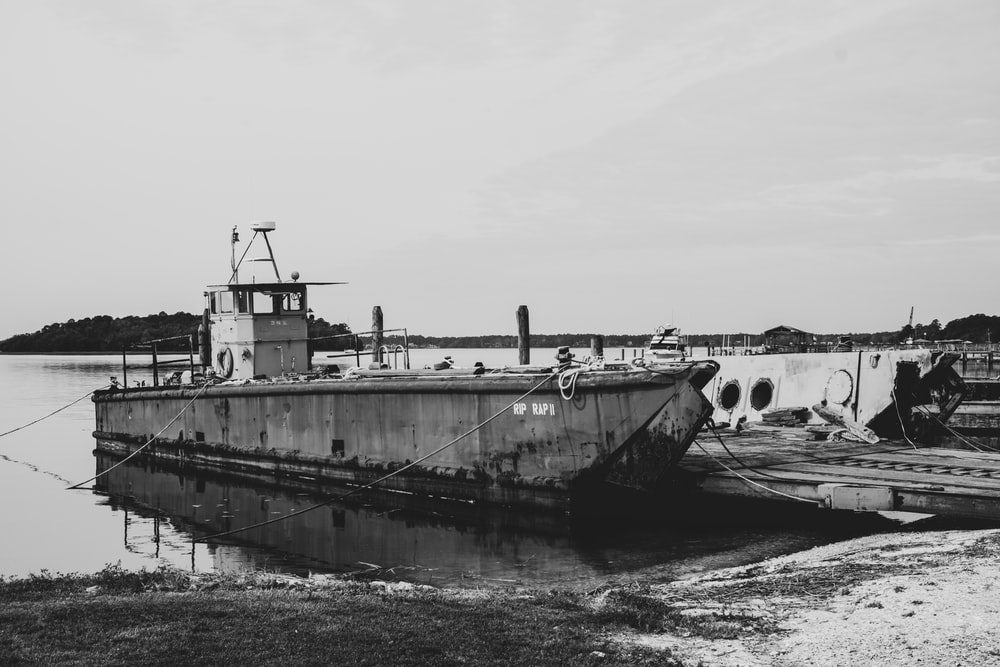 grayscale photo of a ship on a body of water