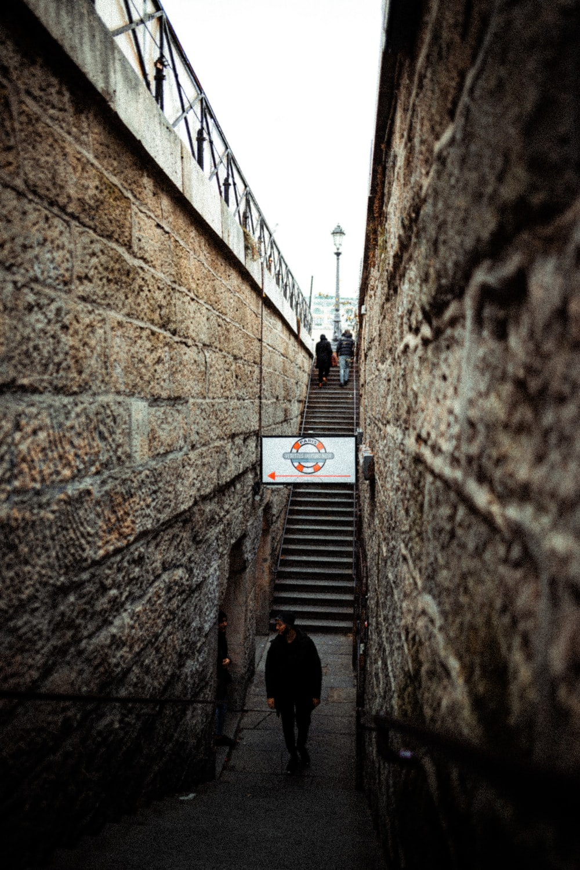 man in black jacket walking on the stairs