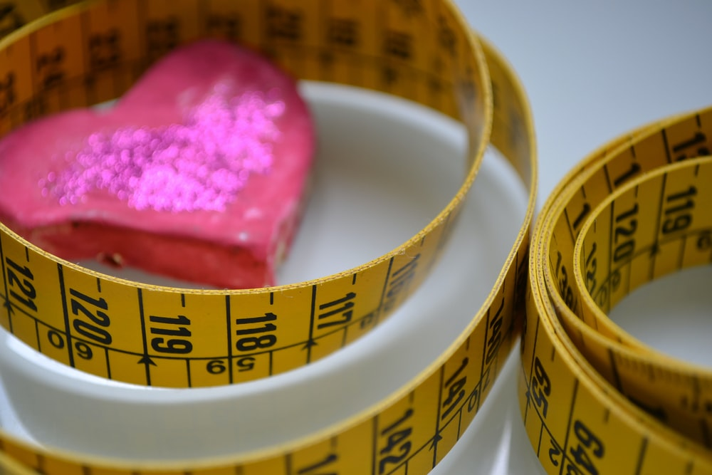 red and yellow tape measure
