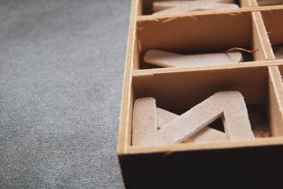 brown wooden box on gray carpet