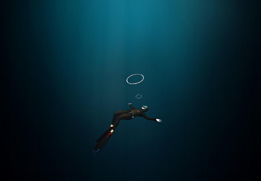 woman in black bikini bottom floating on water