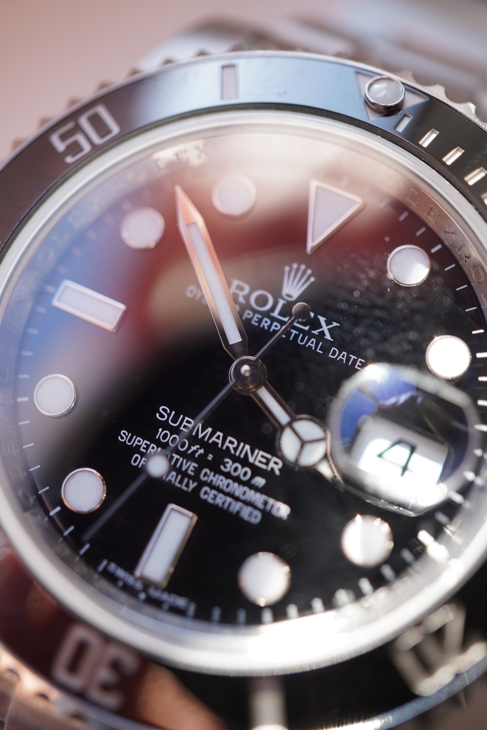 silver and blue round analog watch