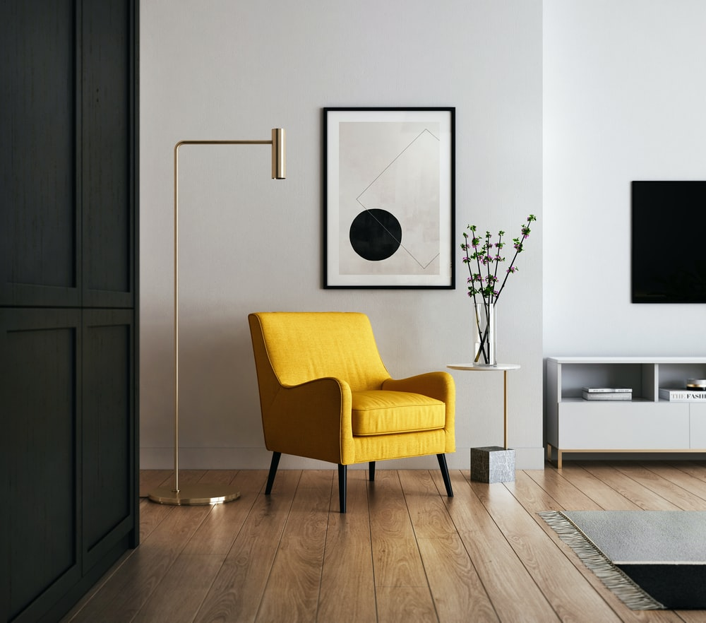 brown wooden framed yellow padded chair