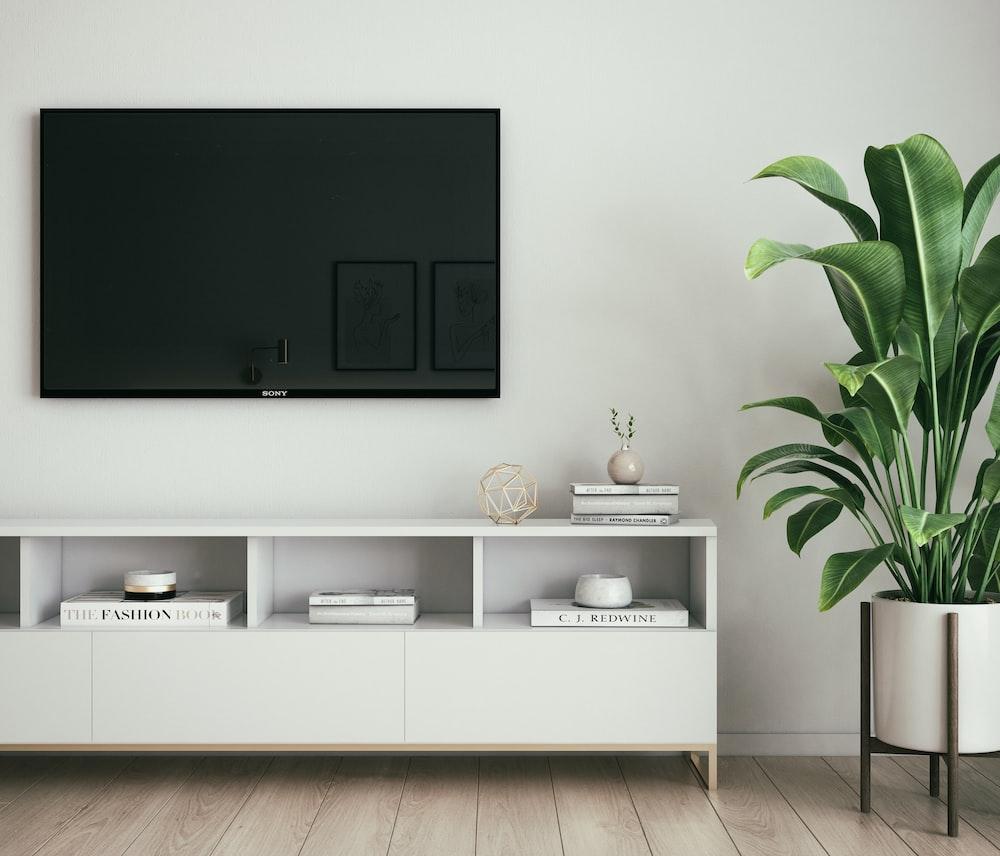 black flat screen tv on white wall