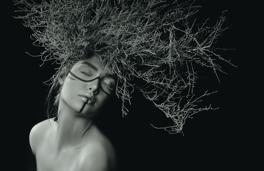 woman with curly hair in grayscale photography