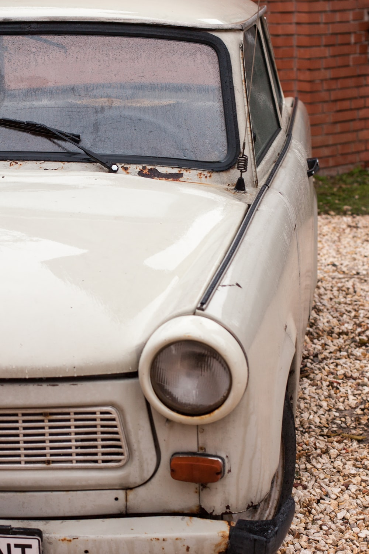 white car on brown soil