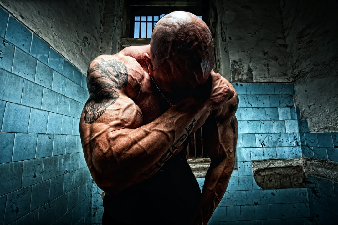 No Regrets - a bodybuilder in the prison cell contemplating escape