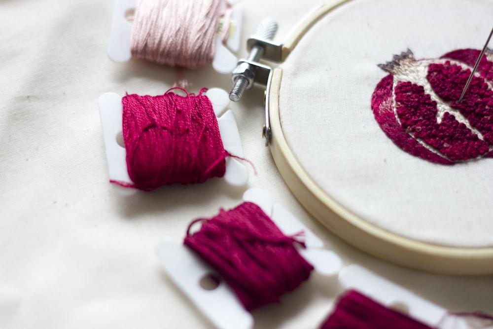 pink thread on white round plate