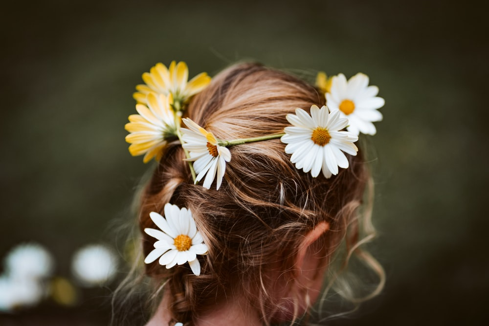 girl with white and yellow flower on her head