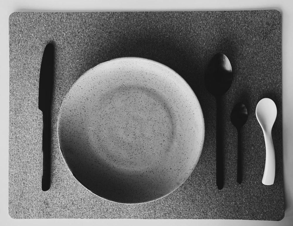 white ceramic plate and silver fork
