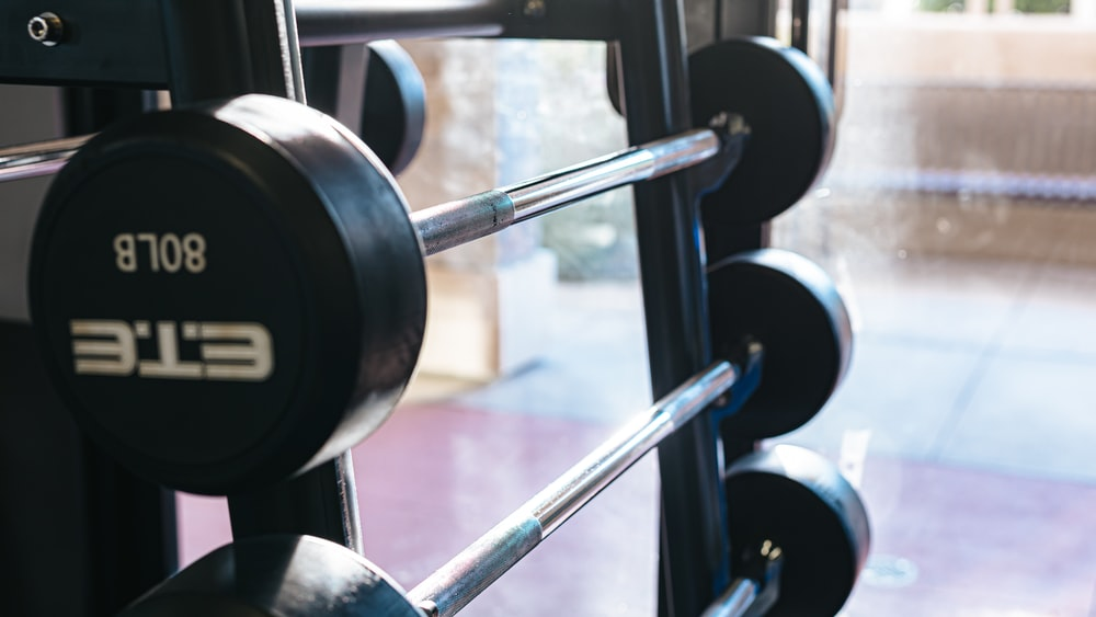 black and silver dumbbell on rack