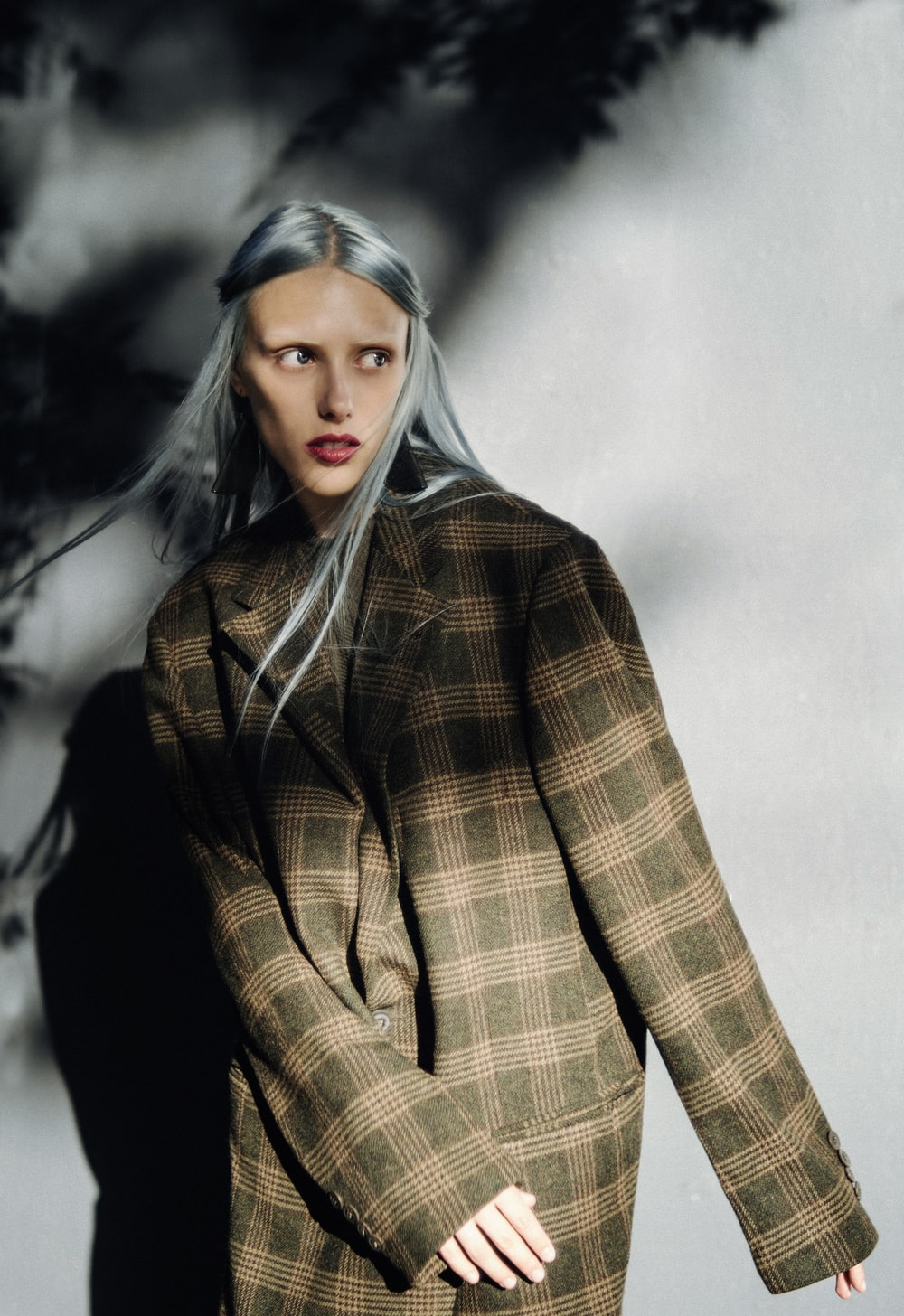 woman in brown and black plaid coat