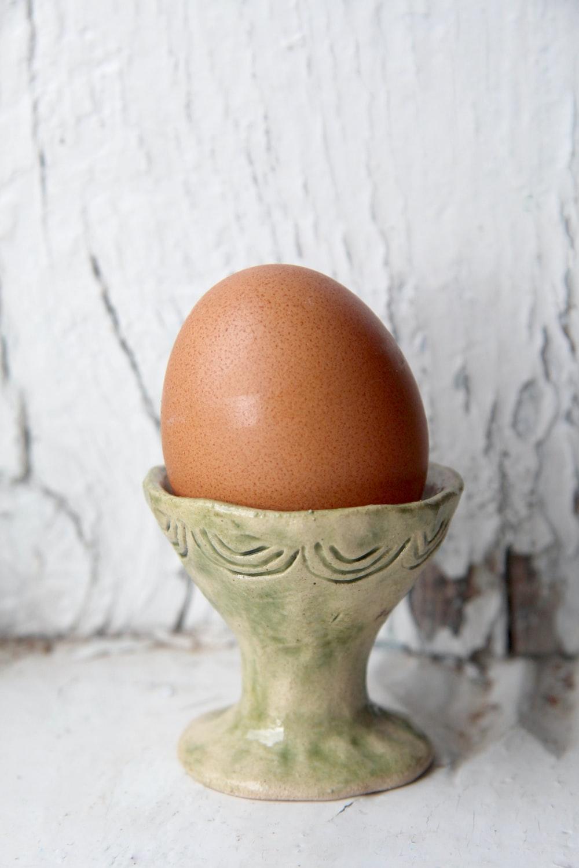 brown egg on gray ceramic vase