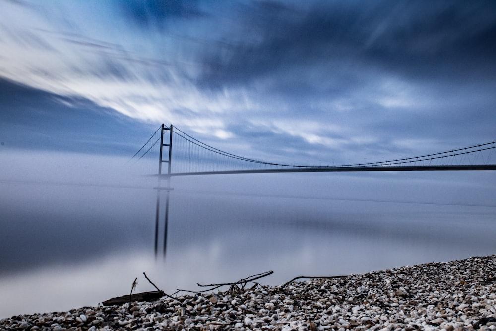 bridge over the lake under blue sky