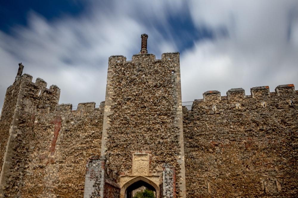 brown concrete castle under blue sky