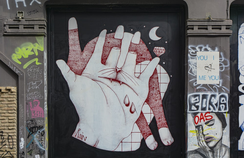 white and red hand print on black board