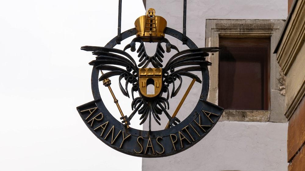 black and gold eagle logo