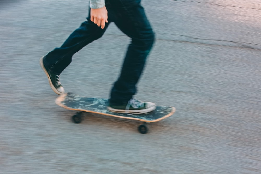person in black pants riding skateboard