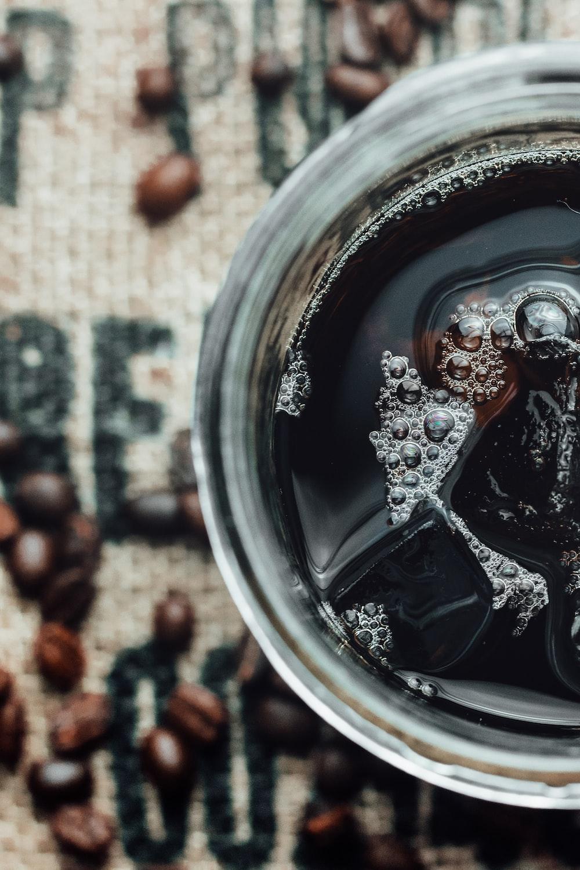 black liquid in clear glass jar