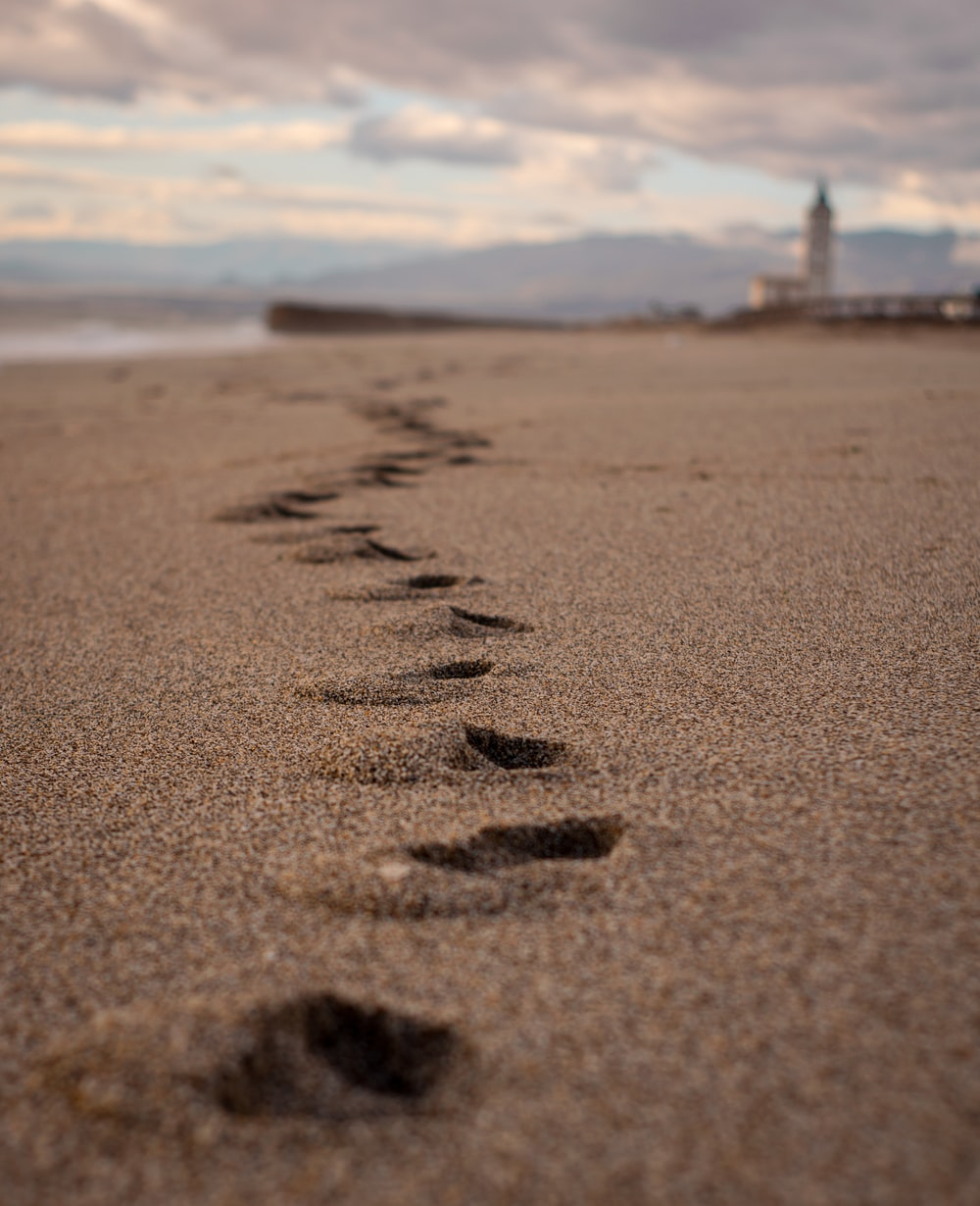 brown sand with foot prints