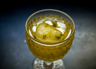 clear glass cup with yellow liquid