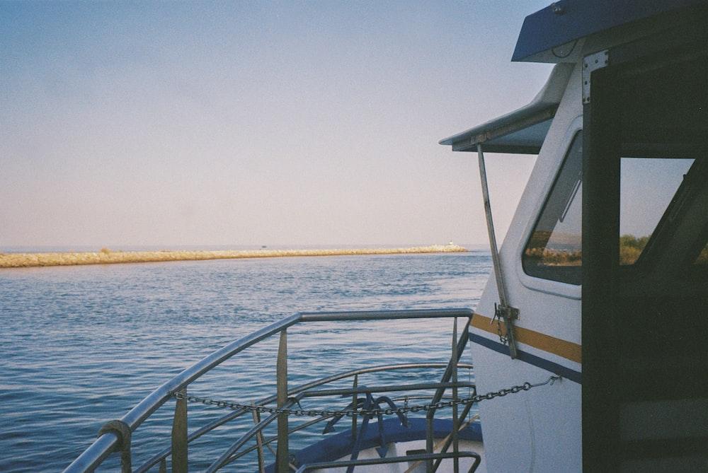 black metal railings near sea during daytime