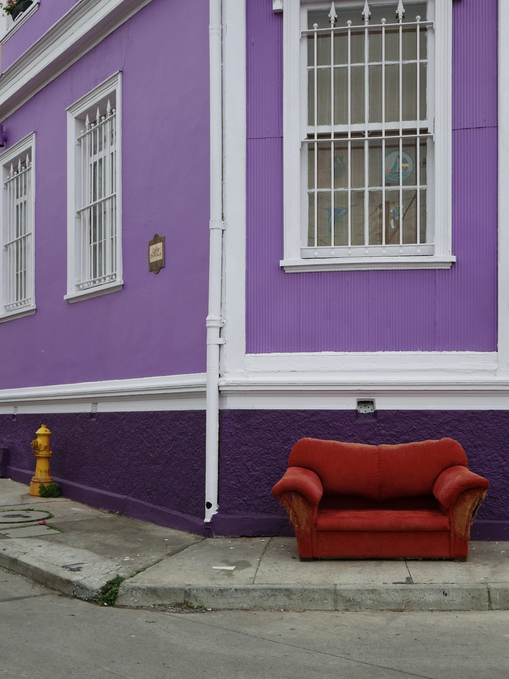 red sofa chair near purple painted wall
