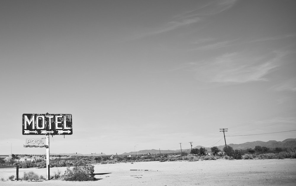 grayscale photo of a road sign