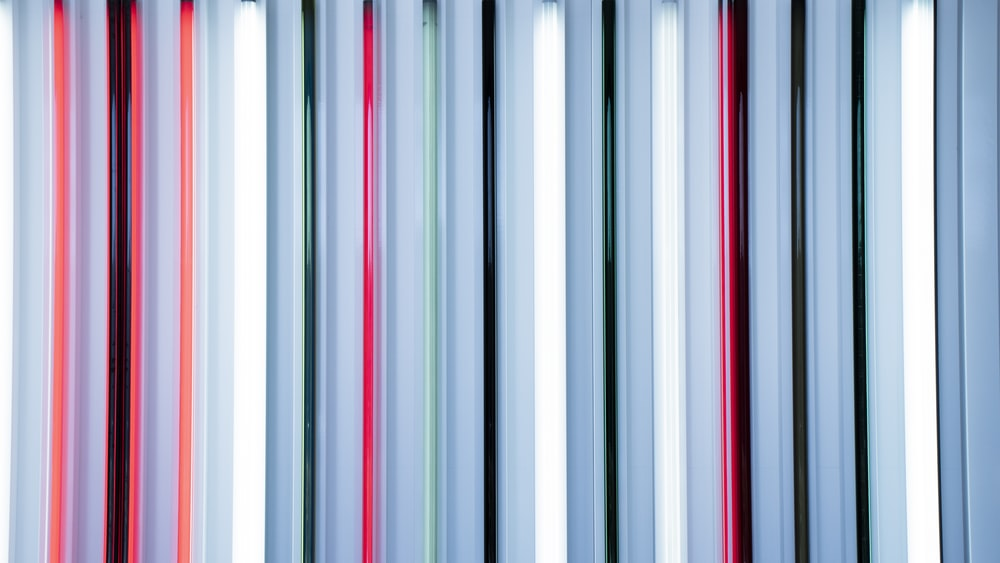 white red and black striped textile