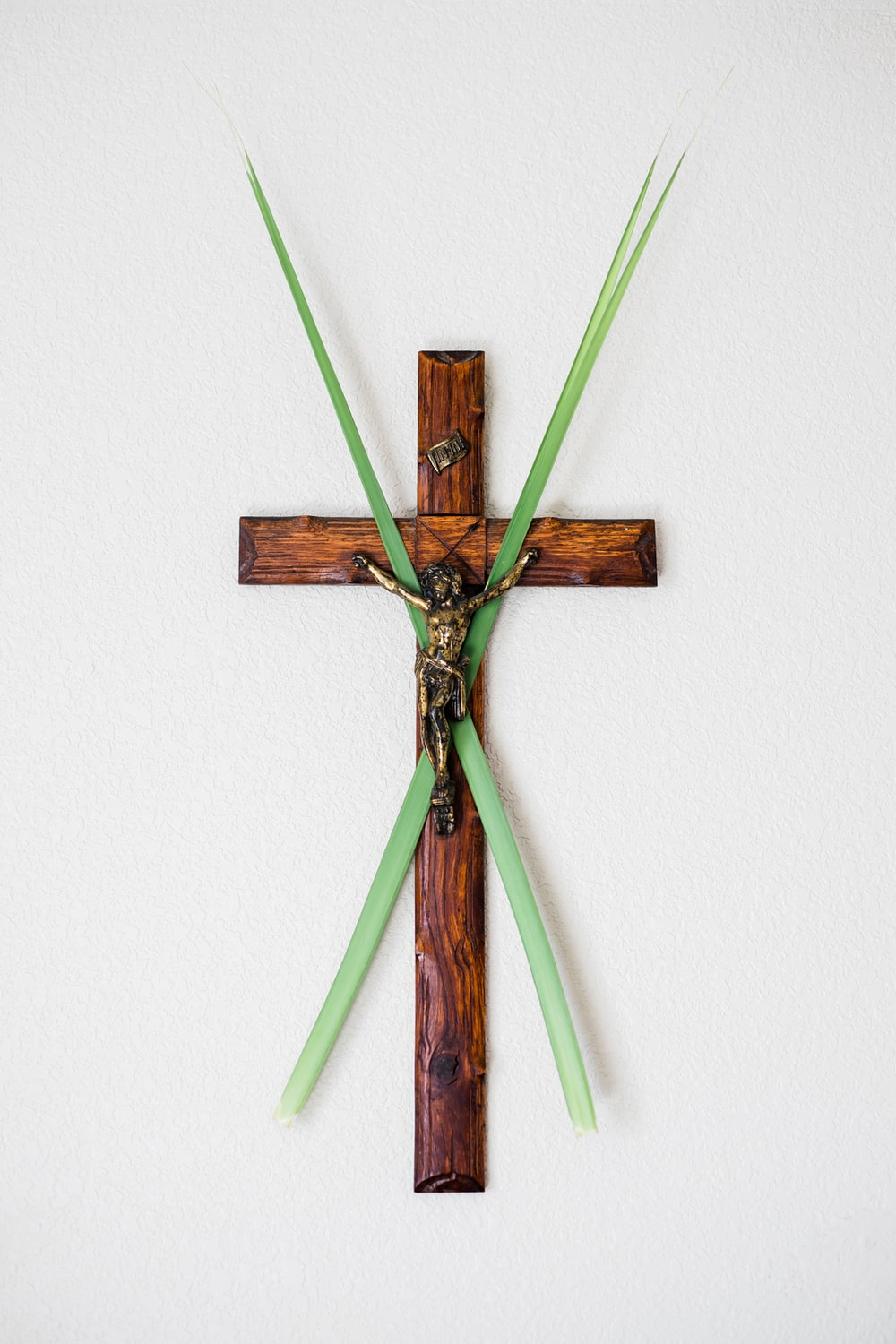 brown wooden cross wall decor