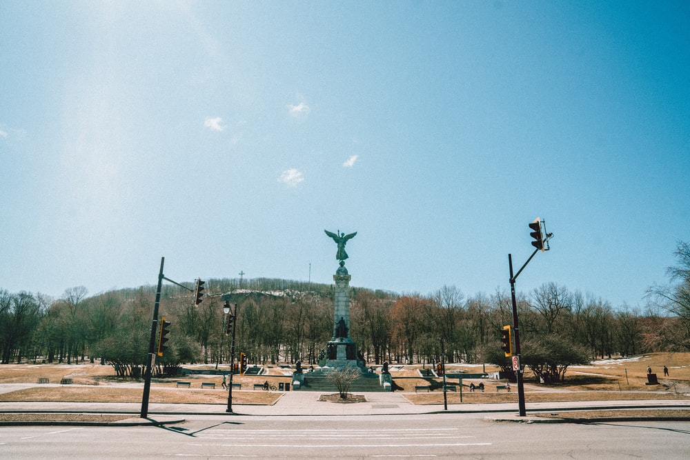 green and brown statue under blue sky during daytime