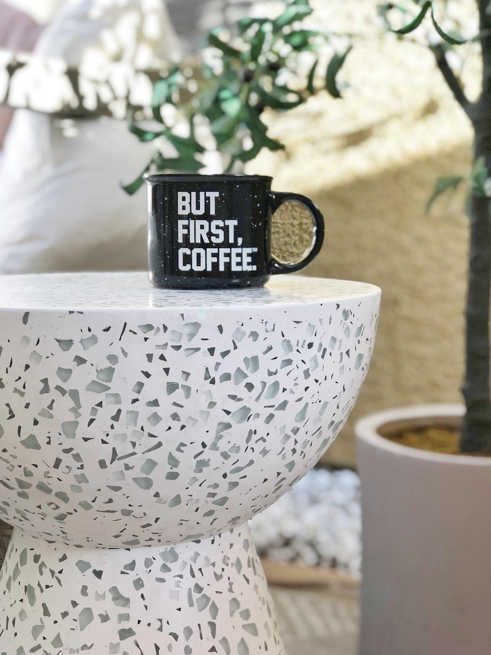 black ceramic mug on white round table