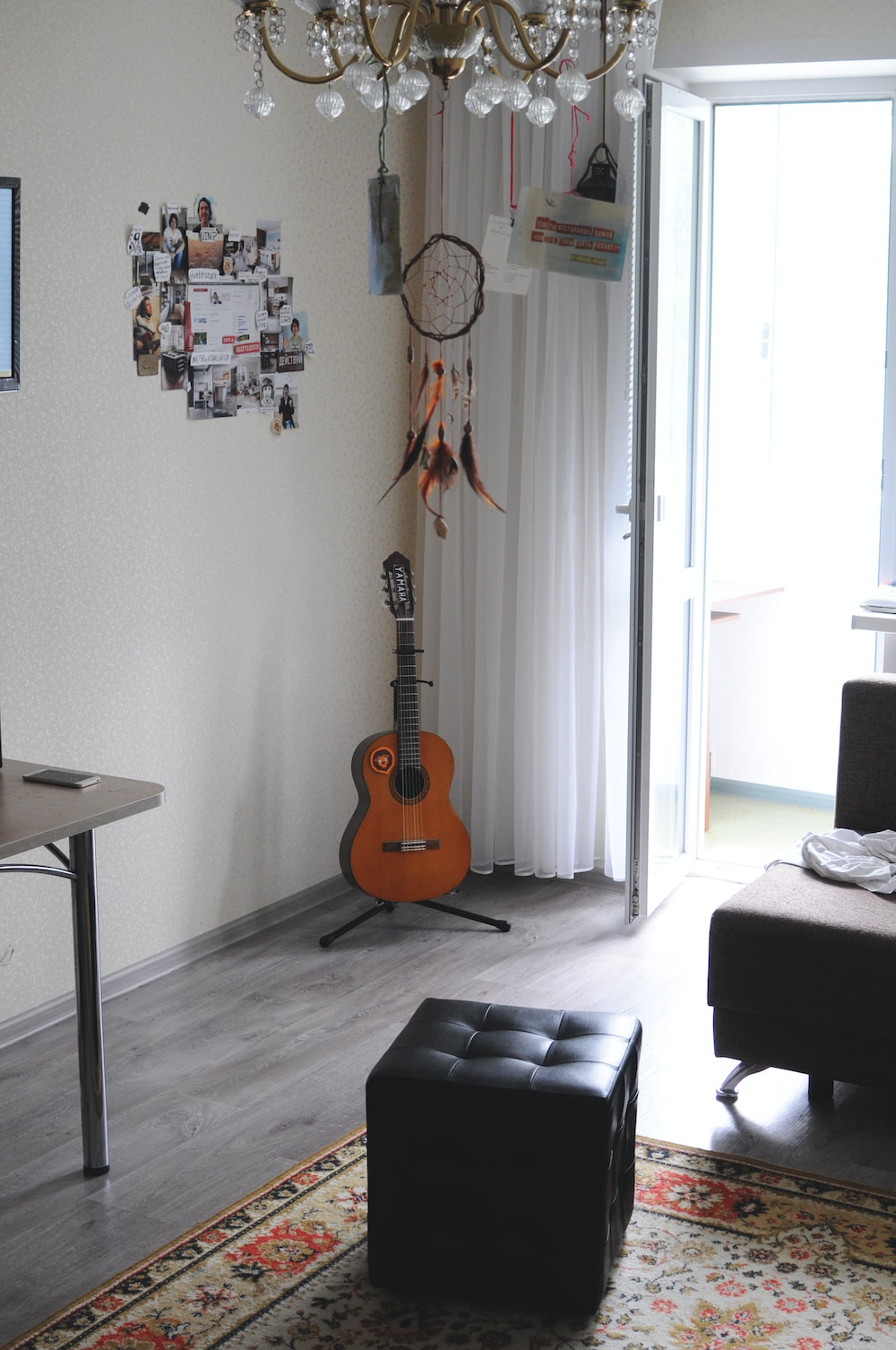 brown acoustic guitar on wall