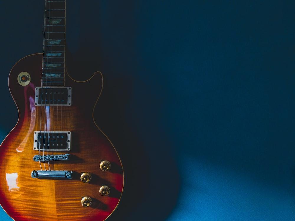 black and brown electric guitar