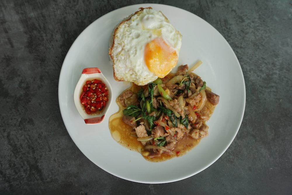 egg with vegetable on white ceramic plate